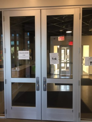 These are the are the tall entrance doors which have glass panels throughout the middle.
