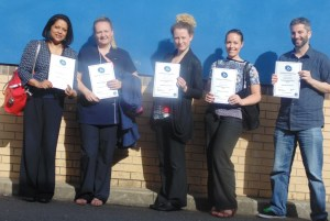 Delegates showing their certificates at the end of a course