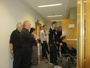 Training delegates studying the different elements of an accessible WC