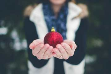 a person holding an ornament