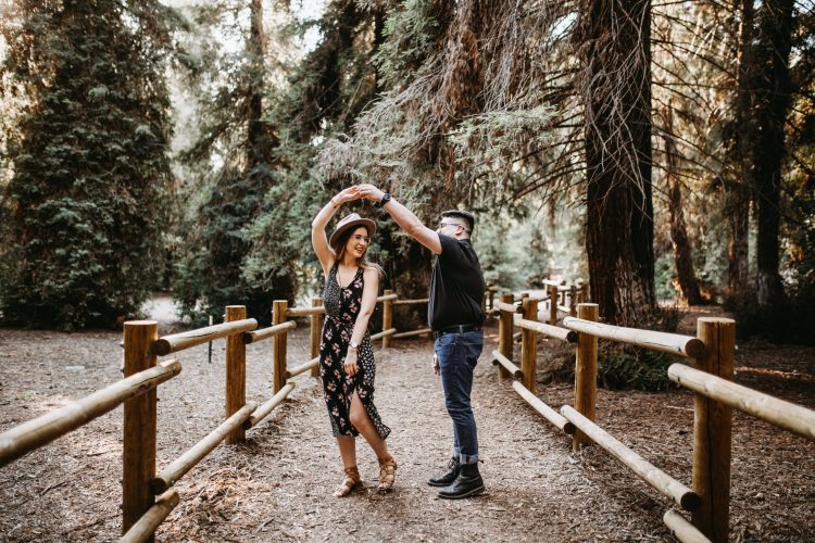 A couple walks together in the woods. They are feeling more connected since starting neurodiverse couples counseling in Houston, Texas with Accessible Career.