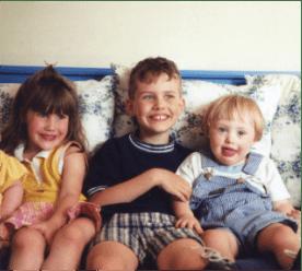Children sitting on couch