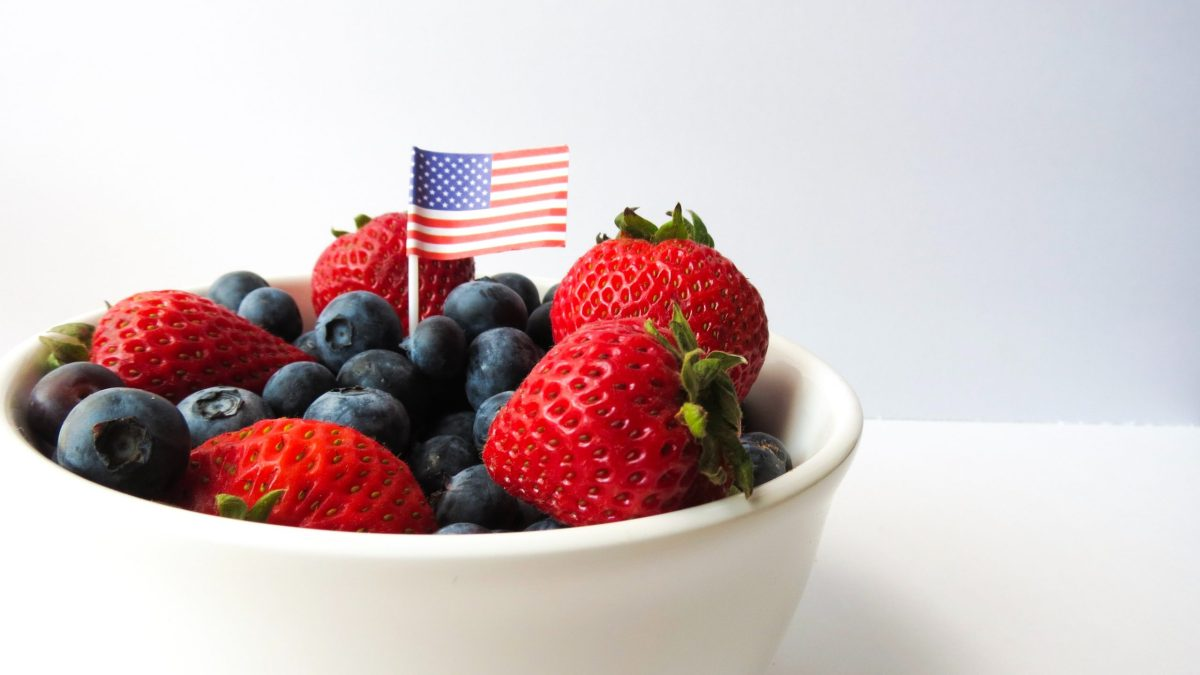 American flag toothpick in a bowl of strawberries and blueberries