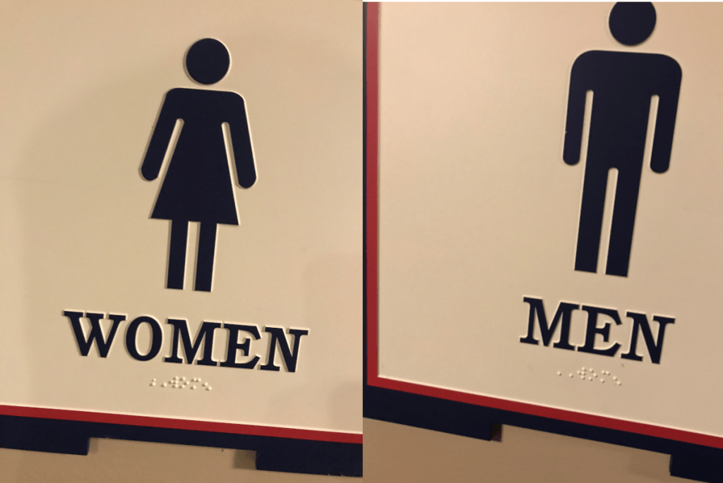 Men's and Women's restroom signs. Both say womens