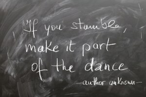 Chalk board with the wording if you stumble make it part of the dance!