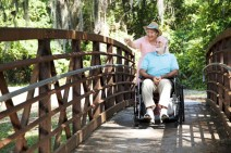senior couple travelling wheelchair