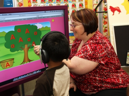 Special Needs teacher Paula Ramsay works on the new TAP-it system with a student.