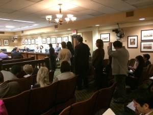 Speakers line up to show support for AJR 39 before a CA Assembly hearing Monday.