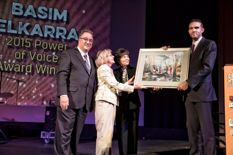 Basim Elkarra, Exec. Dir. for the Council on American-Islamic Releations, Sacramento Valley Chapeter presents a thank you gift to (from left) Access Sacramento Executive Director Gary Martin, Board of Directors chair JoAnn Fuller and Treasurer Nahid Kabbani. (Photo by Tia Gemmell Photography)