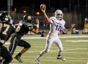 Franklin star Quarterback #12 Jacob Lopez will not play again Pleasant Grove because of an injury. [Photo Courtesy: SacBee.com]