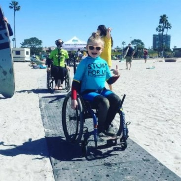Access Trax with girl using wheelchair