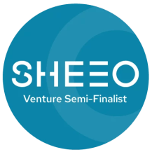 "Image shows blue circle with white text inside: ""SheEO Venture Semi-Finalist"""