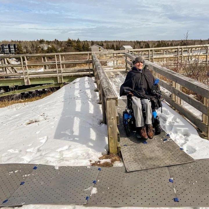 Person in Wheelchair using Access Trax over Snow