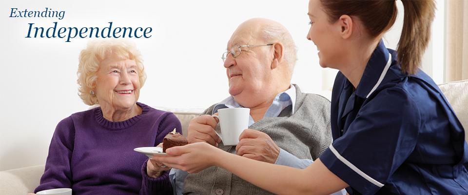 Senior couple having desert with health care provider