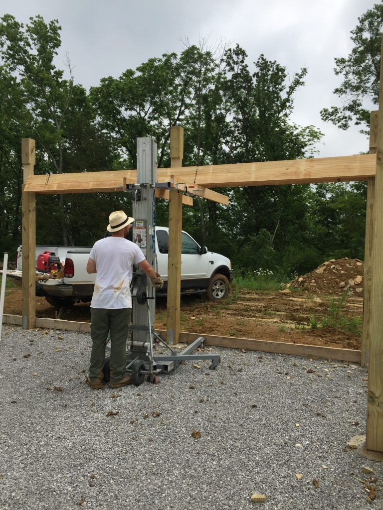 Raising the headers of a pole frame with a lift