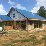 A cordwood house in progress at accidentalhippies.com