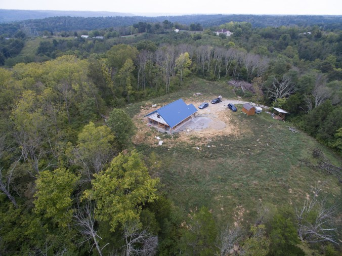 Backside of our cordwood house, not yet completed - accidentalhippies.com