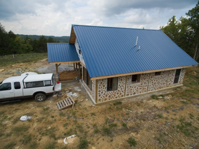 Cordwood house in progress - the east wall is finished! - accidentalhippies.com