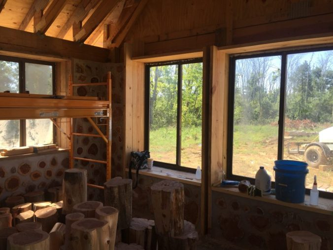 Interior of a cordwood house under construction - at Accidental Hippies