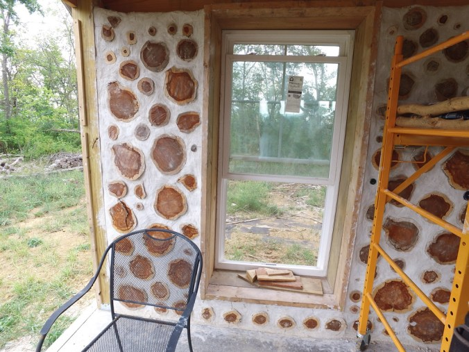 A completed cordwood panel - the first panel completed in this project! - accidentalhippies.com