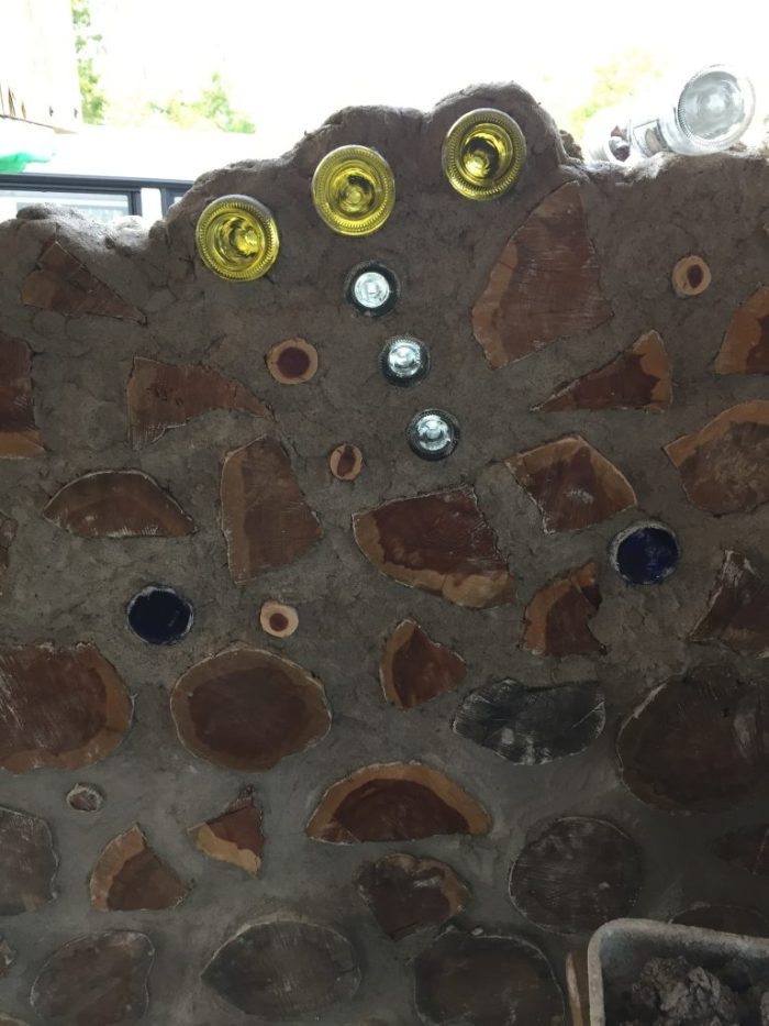 You can use bottle bricks to make designs in a cordwood wall. Here you see the bottom half of the constellation Orion in progress in a wall.