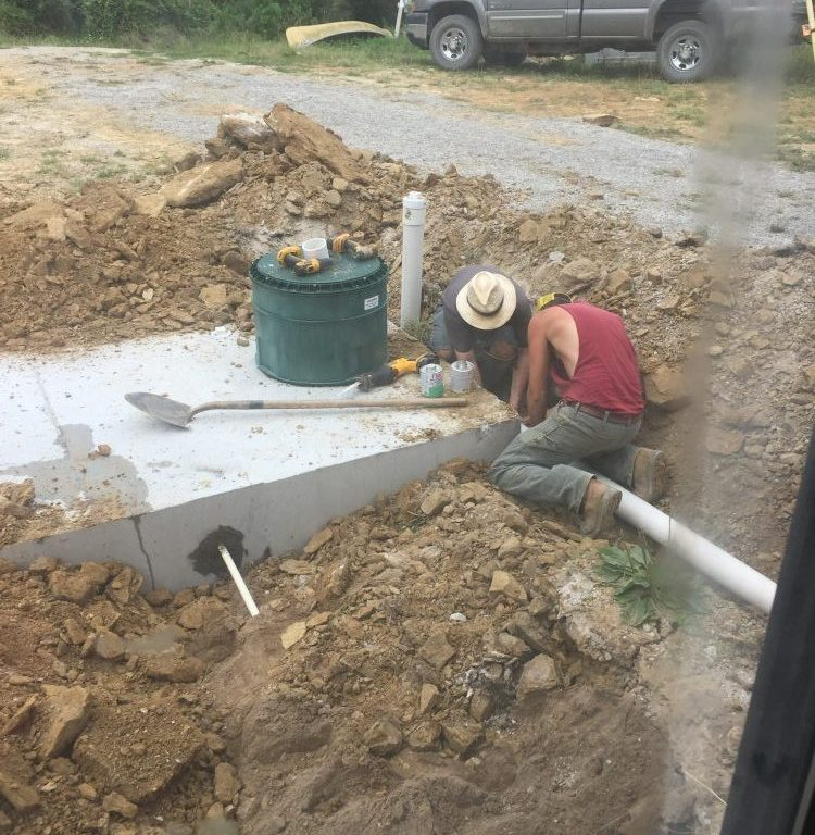 This is what it looked like to install our precast concrete cistern. We use it for catching rainwater for our off-grid home. Learn more here.