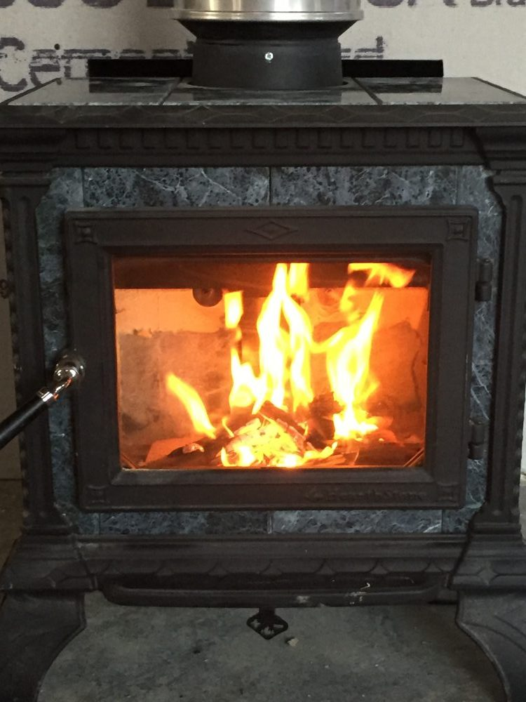Burning in our soapstone wood stove is one of the many tasks we completed during this phase of our home build. Learn more in our progress reports!