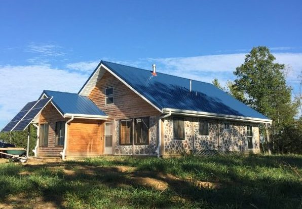 Off grid cordwood house in Kentucky made of eastern red cedar
