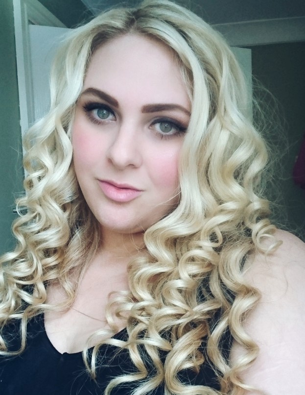 Me, looking smug with some big bouncy curls.The Best Tips to Give Your Hair Volume