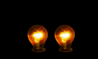 Two light bulbs in the dark, not touching, to symbolise the fact I can't get a cleavage!
