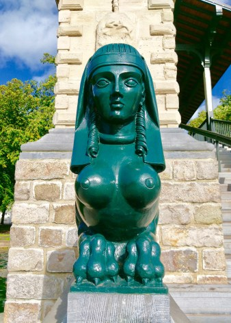 Some weird green statue of a lady whose boobs are pointing in opposite directions to symbolise that I can't get a cleavage