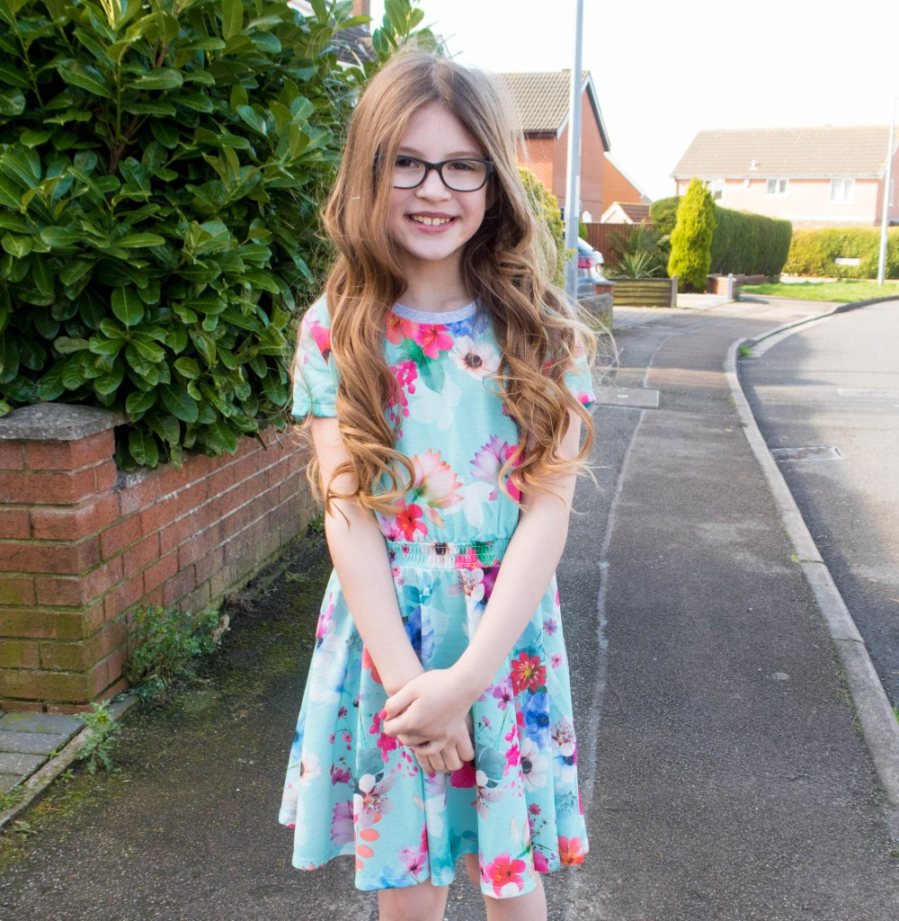 Emma wearing one of Monsoons girls spring dresses. This one i tuqioise and made out of jerseu fabric with pink flowers