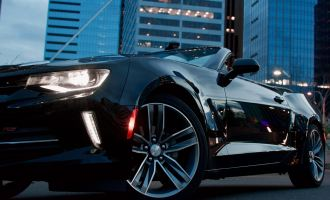 benefits of leasing a car. Close up of black car wheel to decorate this article