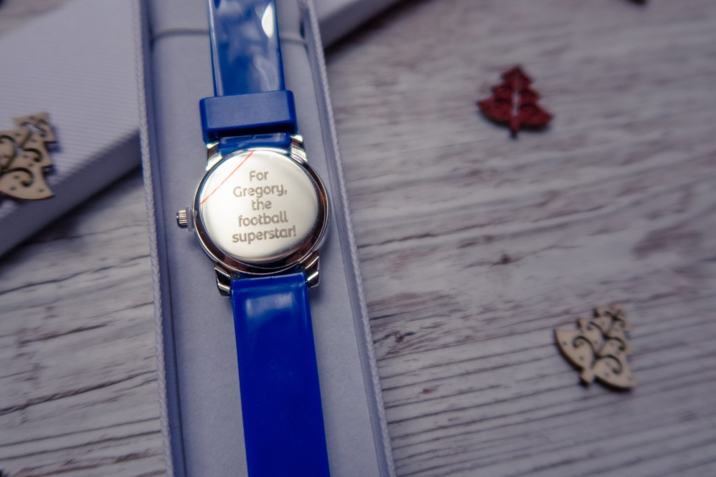 """A personalised back of the watch reading """"For Gregory, the football superstar"""""""