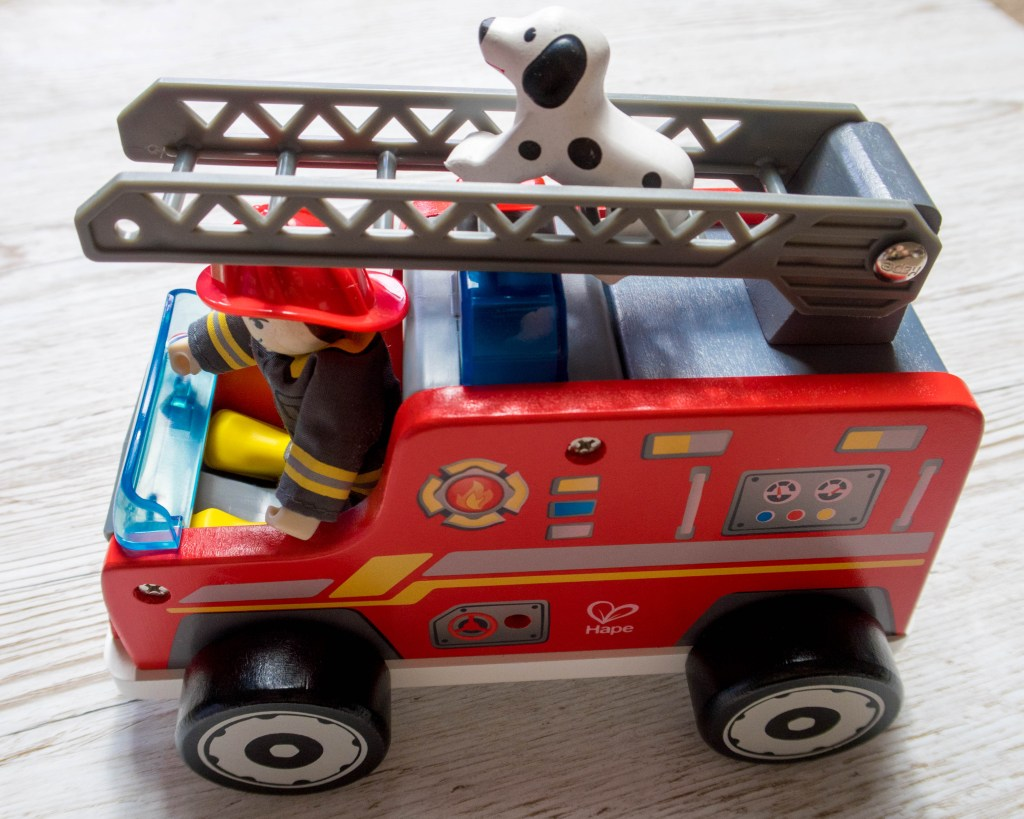 Hape fire engine with man, dog and ladders