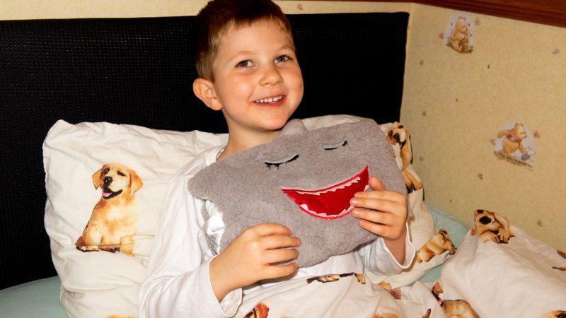 Greg hugging a dream pillow