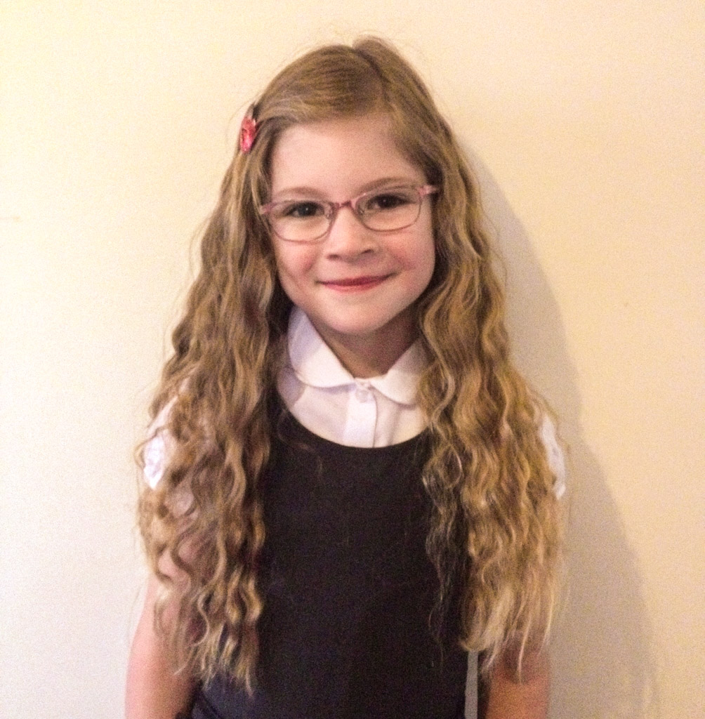 Emma with very long curly hair