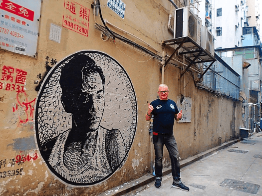 Image-of-hkwalls-mural-of-Canto-pop-legend-Lesie-Cheong--with-Michael-Taylor-in-Sham-Shui-Po-Hong-Kong