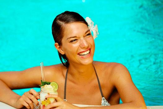 Image-of-model-in-swimming-pool-at-Villa-Kubu-in-Seminyak-Bali
