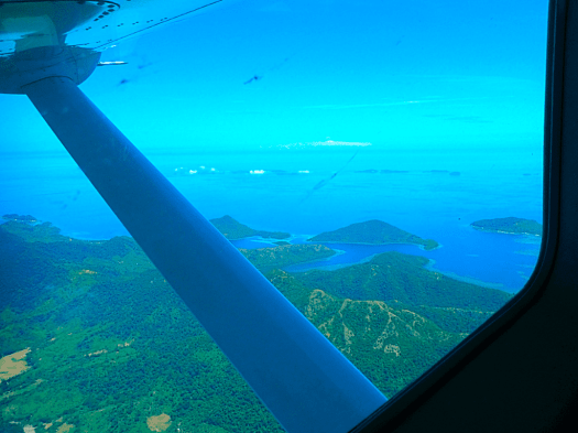 aerial-seascape-view-from-window-of-air-juan-cessna-caravan-ex-over-philippines