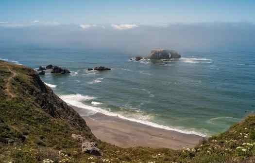 Sonoma-county-goat-rock-beach-credit-frank-schulenburgFog_rolling_over_Arched_Rock