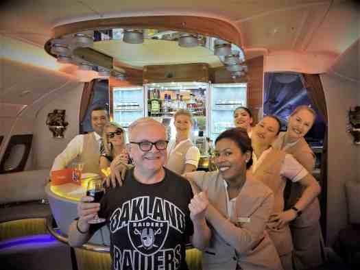 passenger-posing-with-flight-attendants