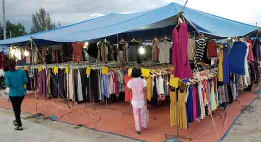 image-of-vendor-selling-garments-at-nai-yang-market-in-phuket-thailand
