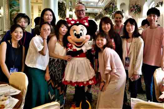 image-of-journalists-posing-with-minnie-mouse-at-hong-kong-disneyland-hotel-enchanted-garden-