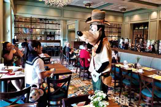image-of-pluto-greeting-girl-at-world-of-colour-restaurant