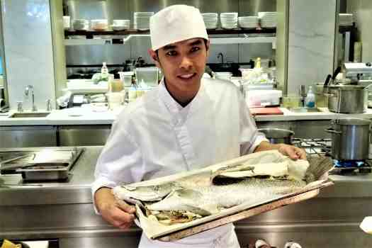image-of-phuket-marriott-resort-nai-yang-beach-chef-holding-fish