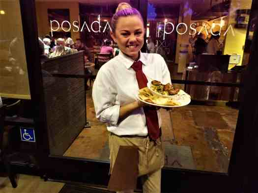 image-of-waitress-with-entree-at-posada-restaurant-in-livermore-california