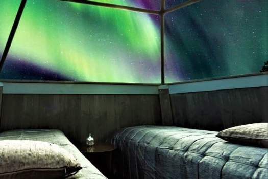 glass ceiling of glass igloo hotel offers views of northern lights