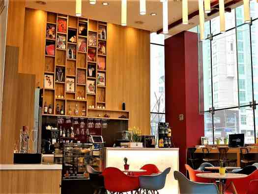 An informal cafe, grab and go in the lobby of Travelodge Dongdaemun in Seoul Korea serves breakfast from 7 am to 10 am
