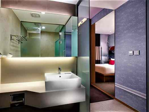 guest bathrooms at travelodge dongdaemun in seoul korea have white vanities with large mirrors